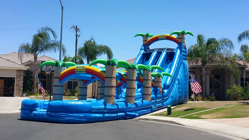 Our newest Water Monster ! A towering 22 foot High and a Slip Sliding 55 feet long, This 2 Lane Bad Boy will Amaze the whole Family and Friends, Non Stop all day $595.00
