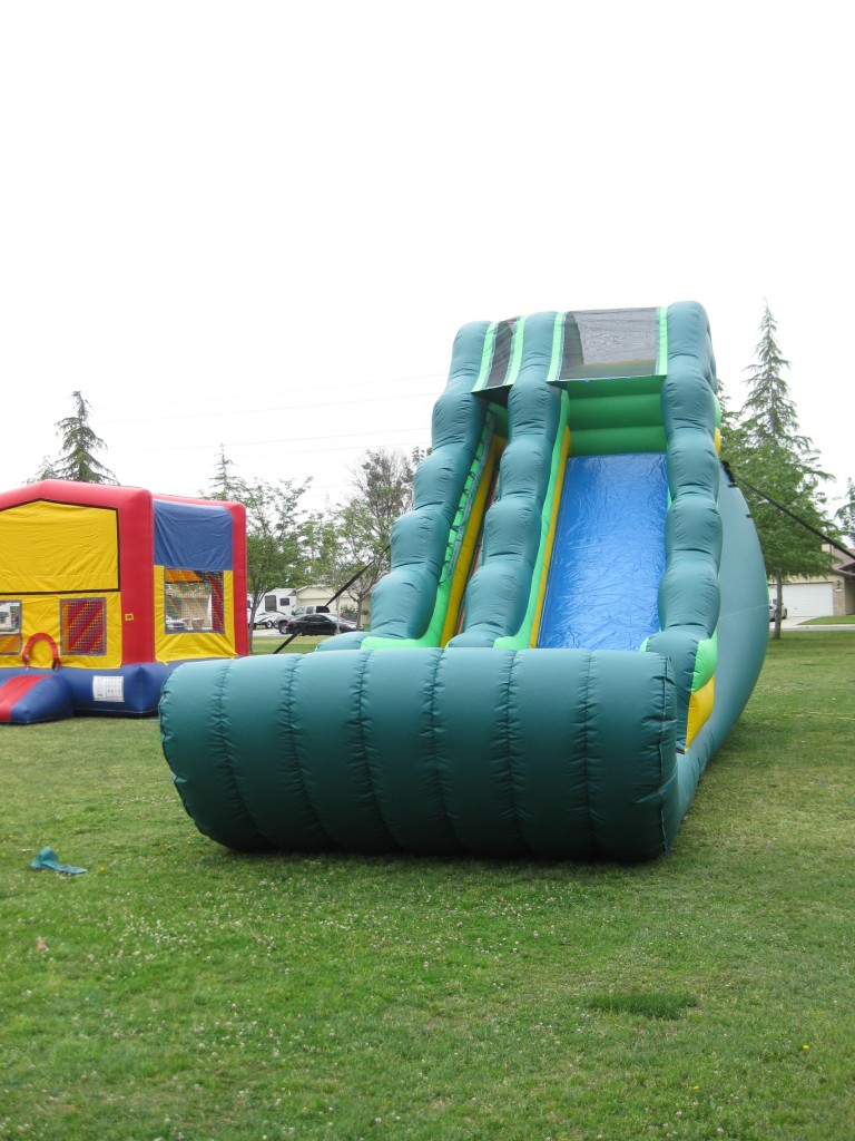 18 FT High Tropical Water Slide with Slip & Slide Sled Front!!! $225.00 All Day 18 High, 36 Long, 14 Wide
