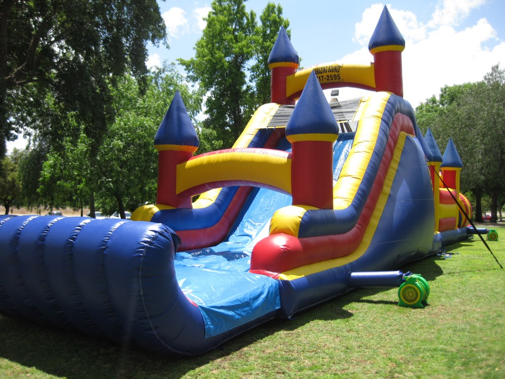 70 FT Obstacle Course with 17FT High Back Load Slide!!! $325.00 All Day!!! 70 Long 13 Wide, 17 High!!!