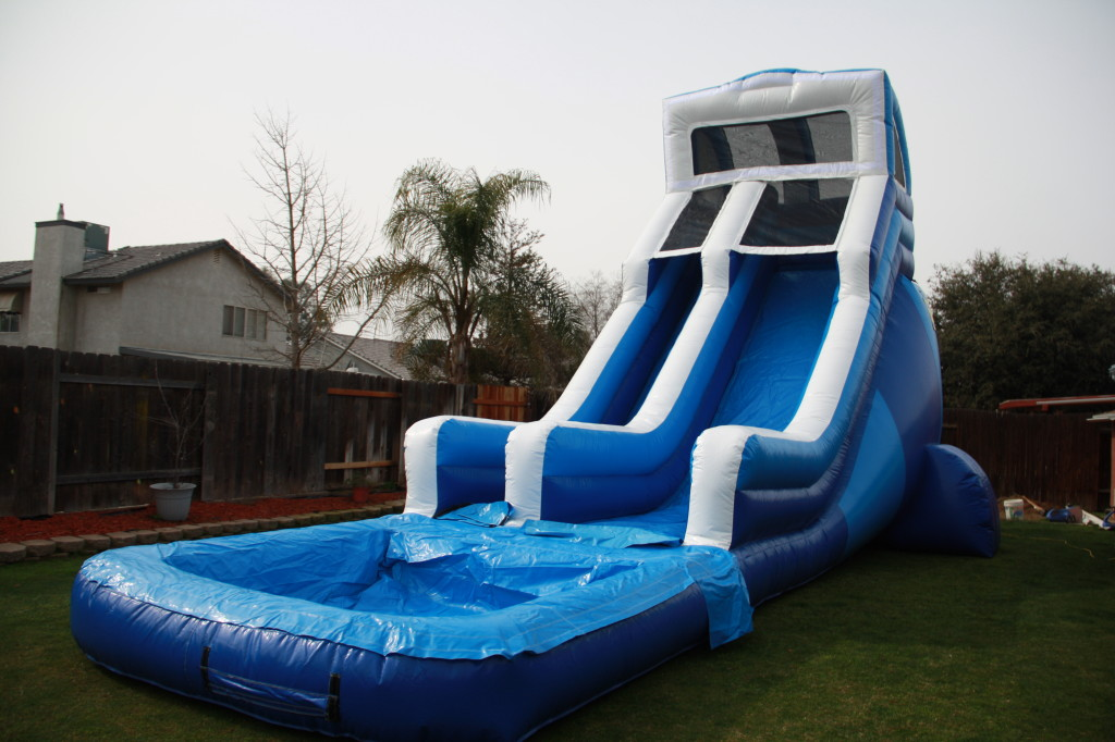 21 ft high x 39 ft long, Giant Surfs Up! Water Slide , Over 60 Themes Available! $375 All Day!