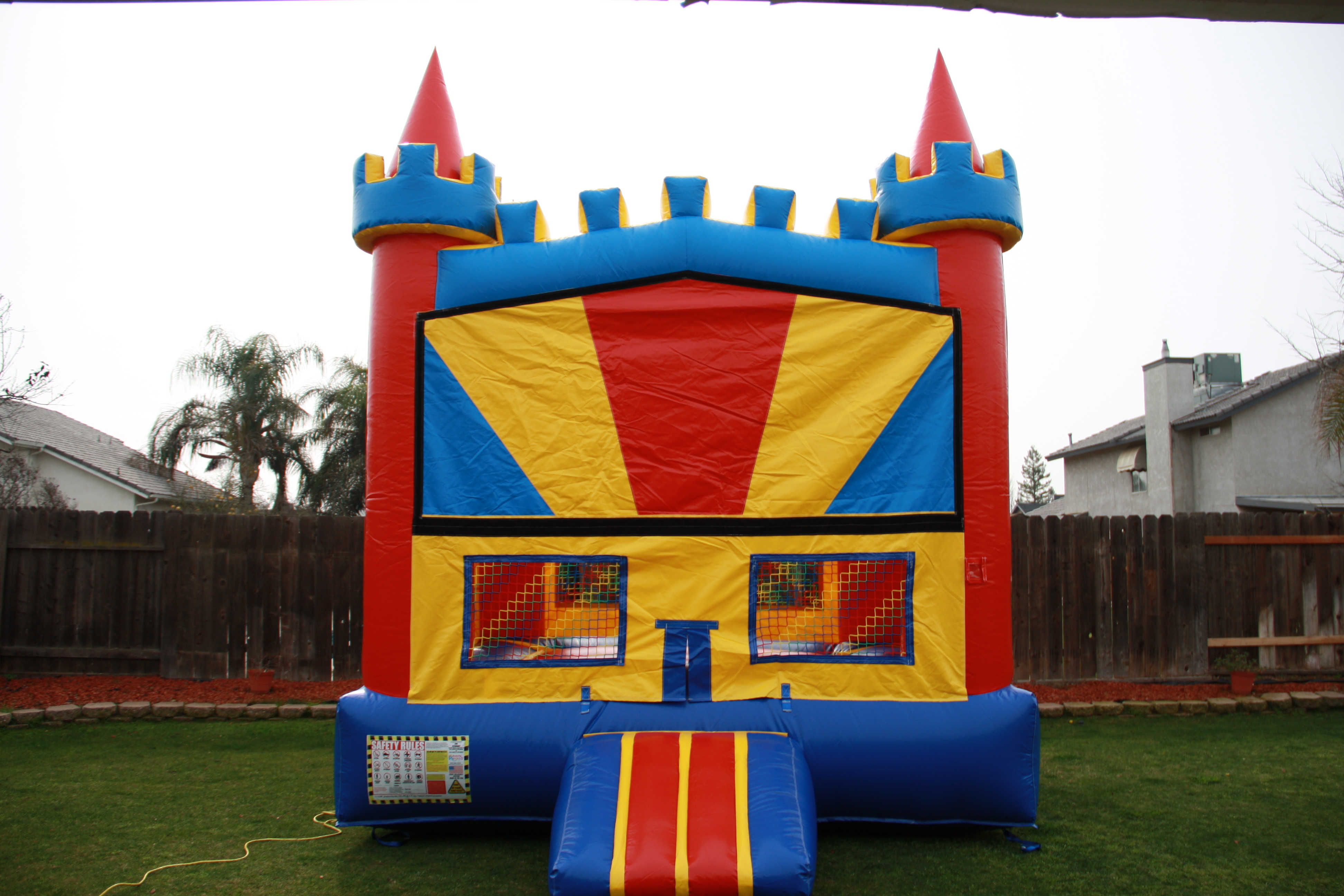 13 x 13 fun house castle with basketball hoop on the inside, over