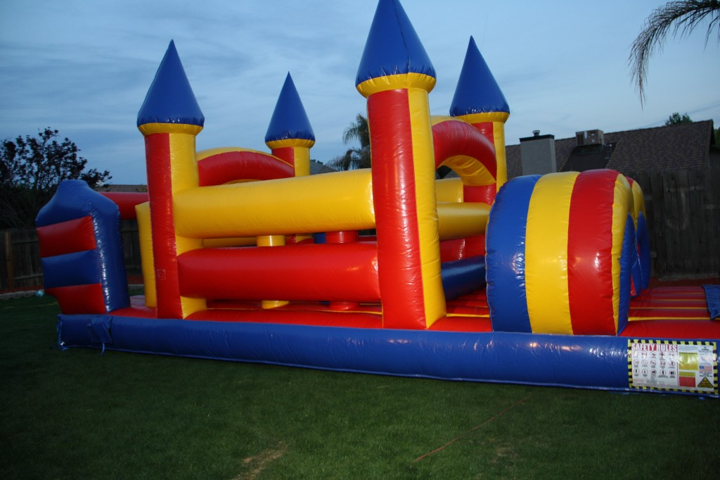 27 foot Amazing Bounce Obstacle Course 27 foot log $150.00 all day!!!